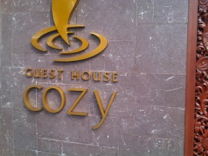 Name and symbol of Cozy guest house Malang