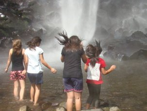 Entering the pool of Coban Rondo Waterfal