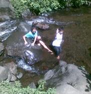Anugerah plays in water of Coban Rondo waterfall