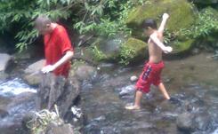 Anugerah at the river of Coban Ondo waterfall Batu