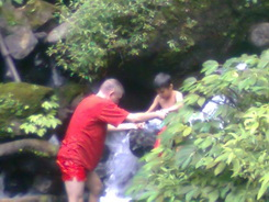 Anugerah is helped by his big friend at Coban Ondo waterfall