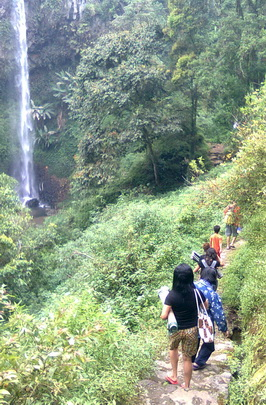 walking down through trap path to Coban Ondo waterfall Malang
